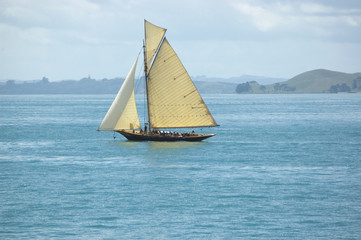 Vacation under vintage sails of leisure yacht