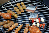 Barbecue grill with meat and fish poster
