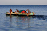Malagasy fishermen and their outrigger canoes poster