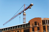 Elevating crane and built house. poster