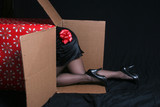 Woman with bow crawling into a christmas gift box poster