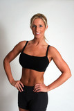 Female Body builder with hands on hips poster