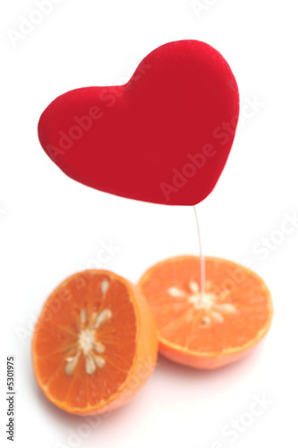 Red heart and orange on a white background