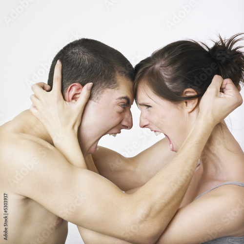 Couple locked in angry embrace