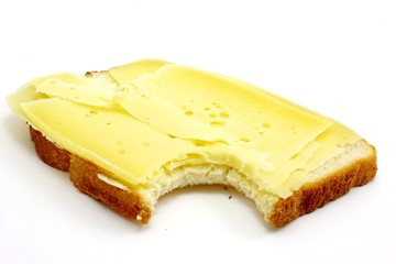 Slice of white bread with dutch cheese isolated on white