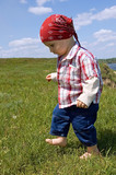 barefooted baby boy to step out briskly against summer landscape poster