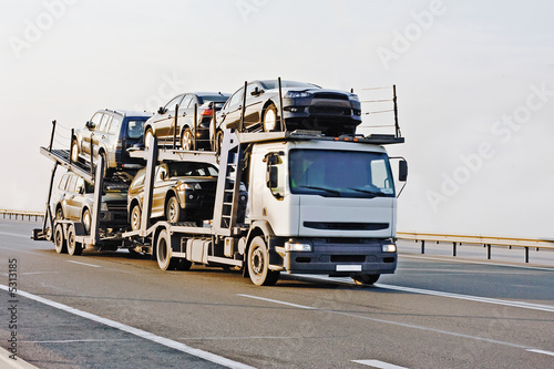 car carrier truck deliver batch to dealer