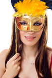 Fototapety Attractive  woman wearing gold carnival mask