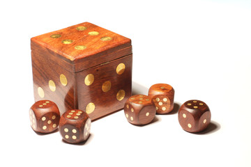 Five small dice and one big die on the white background.