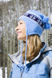 attractive smiling blond woman wearing blue ski clothing.