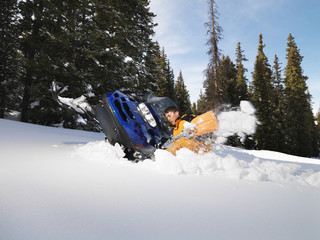Man with stuck snowmobile.