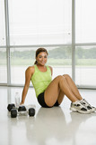 Female weightlifter resting. poster