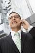Businessman using mobile phone, portrait
