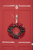 Christmas wreath hanging on door