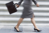 Businesswoman walking quickly, low section