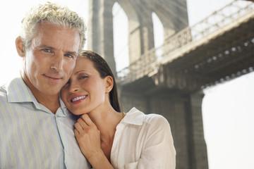 Couple under Brooklyn Bridge