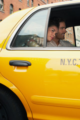 Couple Riding in Taxi Cab