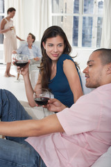 Couples Talking at a Party