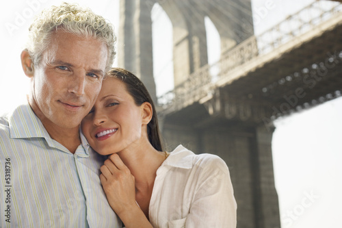 Couple under Brooklyn Bridge