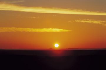 Yellow Sun on Orange Horizon