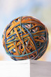 Rubber Band Ball resting on book