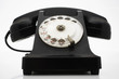 Old fashioned black telephone in studio
