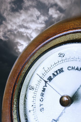 Barometer in front of cloudy sky, digital composite