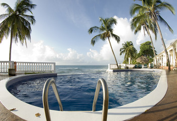 infinity pool with float caribbean sea