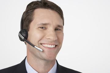 Smiling man talking on Telephone Headset