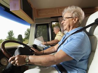Senior woman driving RV.