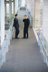 Businessmen in Hallway