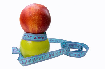 green apple and peach with measuring waist isolated on white