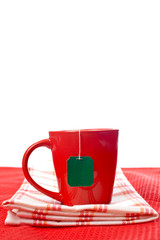 Red cup with tea-bag