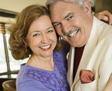 Portrait of mature couple embracing and smiling. poster