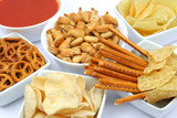 Pretzels, salty sticks, fish crackers and chips with salasa dip poster