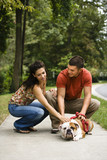 Couple petting dog. poster