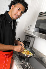 young chef cooking dinner