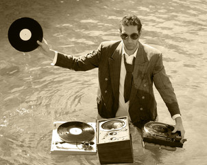 a young dj plays music in the sea