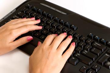 beautiful woman hands over black keyboard