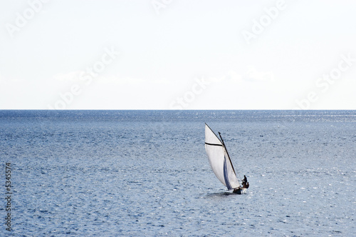 Sailing boat in open sea