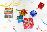 Colorful gifts with shining ribbons on white background poster