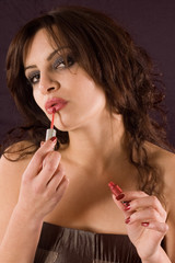 Young beauty woman applying lipstick for her beauty
