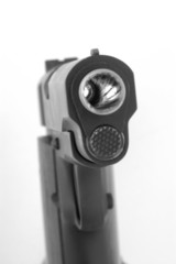 .45 caliber handgun with light in barrel