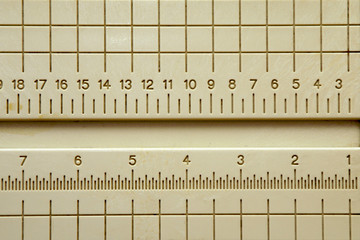 plastic ruler with grid with numbers going backwards