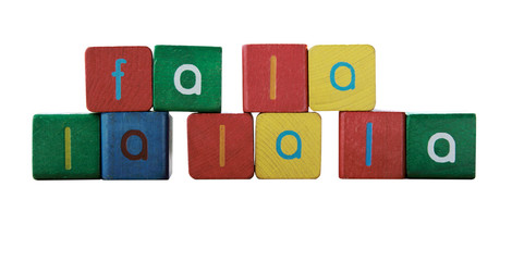 the words 'fa la la la la' in colorful children's block letters