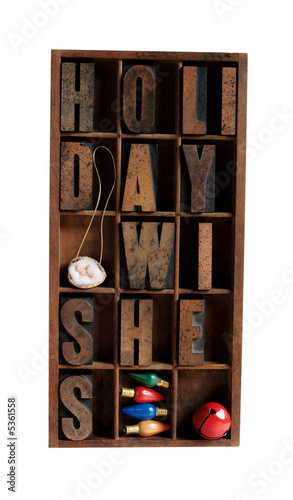 holiday wishes in letterpress type in an old wood case