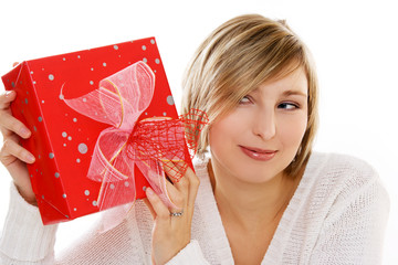 winter portrait of a smiling woman with a gift