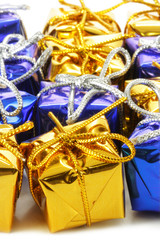 Lots of colorful gift boxes over white background