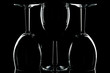 Low key shot of three wine glasses against black.