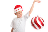 Child watches  large bauble spin around with much delight.. poster